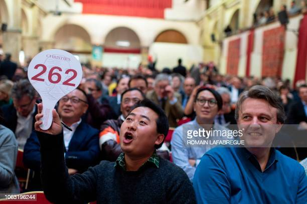A buyer bids during the 158th charity wine auction at the Hospices de Beaune central France on November 18 2018 The Hospices de Beaune charity wine...
