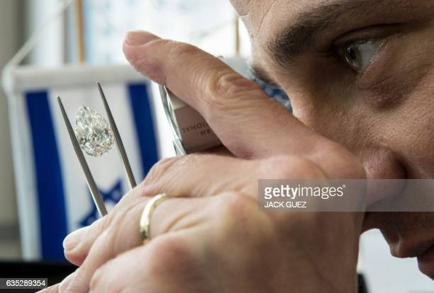 A buyer checks the quality of an 86 carat diamond during the International Diamond Week in the Israeli city of Ramat Gan east of Tel Aviv on February...