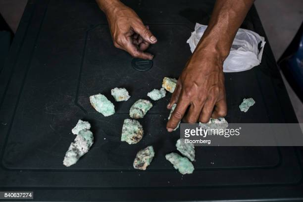 A buyer displays emeralds at the entrance of a mine in Muzo Colombia on Friday Aug 4 2017 Colombia is the world's largest producer of emeralds The...