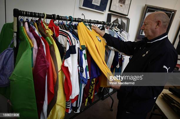 Buyer John Ansbro looks at a Brazil No 3 international football jersey at Sotheby's on November 6 2012 in London England Graham Budd auctioneers are...