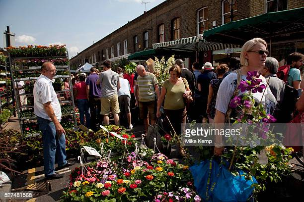 Buyers and sellers at East London's famous Sunday flower market on Columbia Road Punters come here from the early hours to snatch up the best of the...