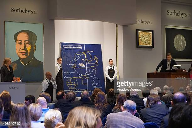 Buyers are seen during an auction at the Christie's in New York on November 12 2015 The two billion dollarplus evening auction season ended on a...