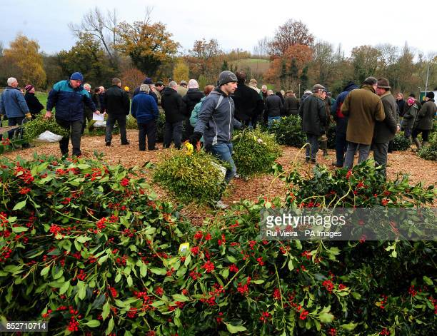 Buyers at the auction sale of holly mistletoe wreaths and Christmas trees at Bromyard Road Business Park Tenbury Wells Worcestershire
