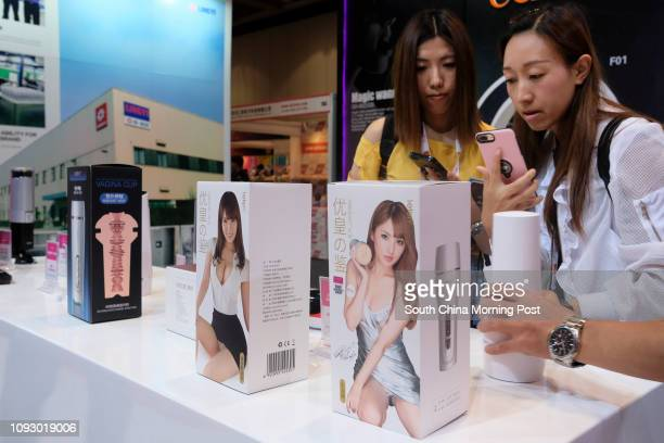 Buyers check sex toys at the Asia Adult Expo 2017 at Hong Kong Convention and Exhibition Centre in Wan Chai Hong Kong 30AUG17 [FEATURES] SCMP / James...