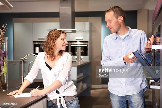 Buyers checking the new ovens in a store.
