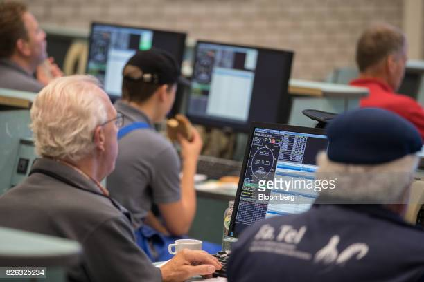 Buyers sit at desktop computers during a fish auction at the port of Den Helder Netherlands on Friday Aug 4 2017 Prime Minister Theresa May will pull...