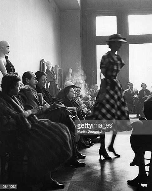 Buyers view the first fashion show by Hubert de Givenchy in Paris Original Publication Picture Post Fashion's New Boy pub 1952