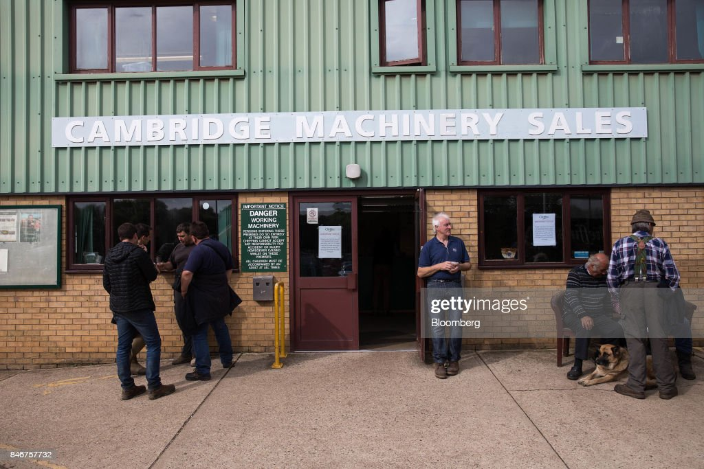 Buyers wait outside the sales office at the Cheffins Cambridge Machinery Sales monthly machinery and plant auction in Sutton, U.K., on Monday, Sept. 4, 2017. The debate over food andfarmingpolicy after Brexit has heated up recently, with Environment Secretary Michael Gove telling BBC Radio 4 that the U.K wouldnt lower its animal welfare or environmental standards to achieve any new trade deals. Photographer: Simon Dawson/Bloomberg via Getty Images
