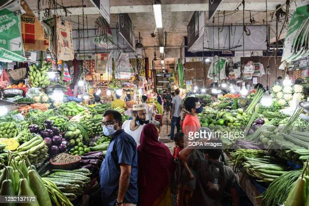 Buyers wearing protective masks are seen in the Mohakhali vegetable market at the beginning of the lockdown in Dhaka.
