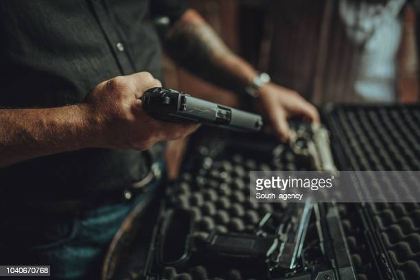buying a gun on black market - weaponry stock pictures, royalty-free photos & images