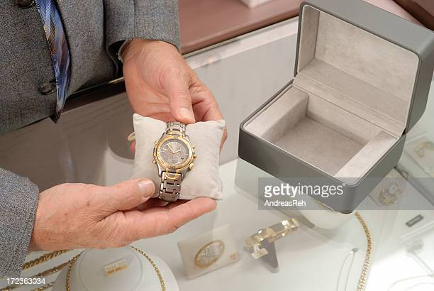 buying a wristwatch - jewelry store stock pictures, royalty-free photos & images