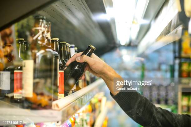 buying beer - alcohol drink stock pictures, royalty-free photos & images
