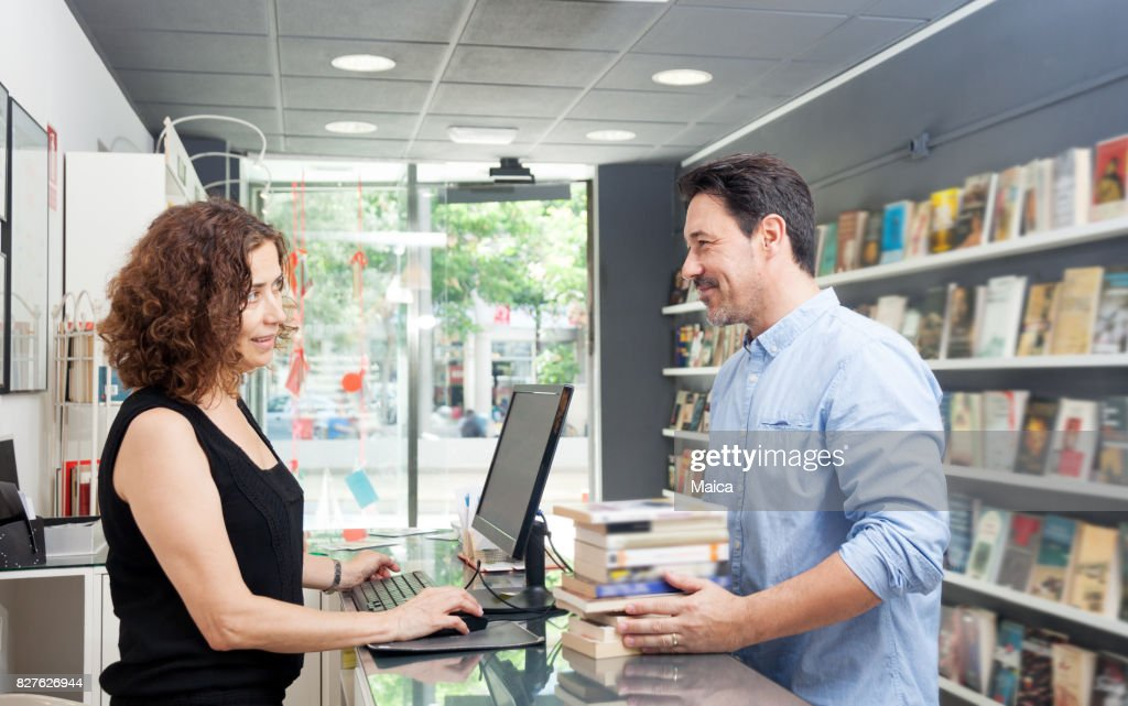 Buying books at a book store : Stock Photo