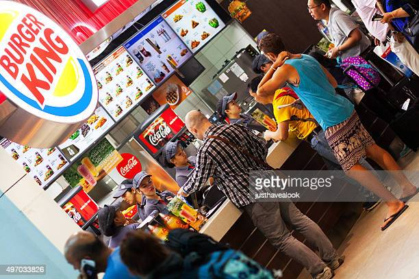 Buying burger and fast food in airport