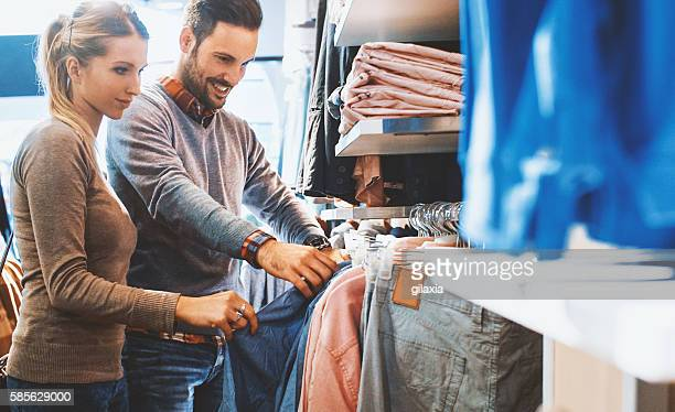 buying clothes at a mall. - boutique stock photos and pictures