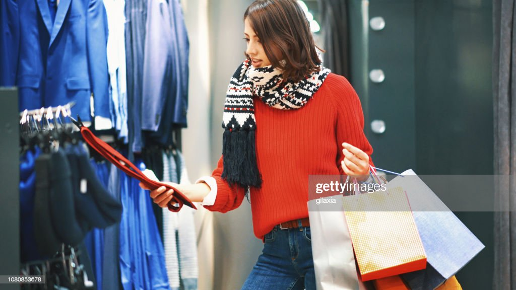 Buying clothes for Christmas. : Stock Photo