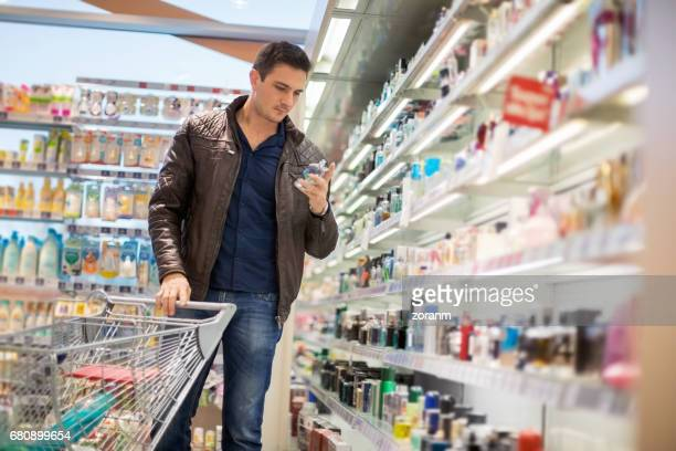 buying cosmetics - grooming product stock photos and pictures