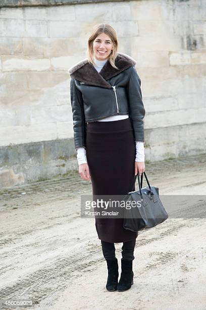 Buying Director for luxury eboutique mytheresacom Veronika Heilbrunner wears a Prada bag and Acne jacket and skirt Gianvito Rossi boots on day 5 of...