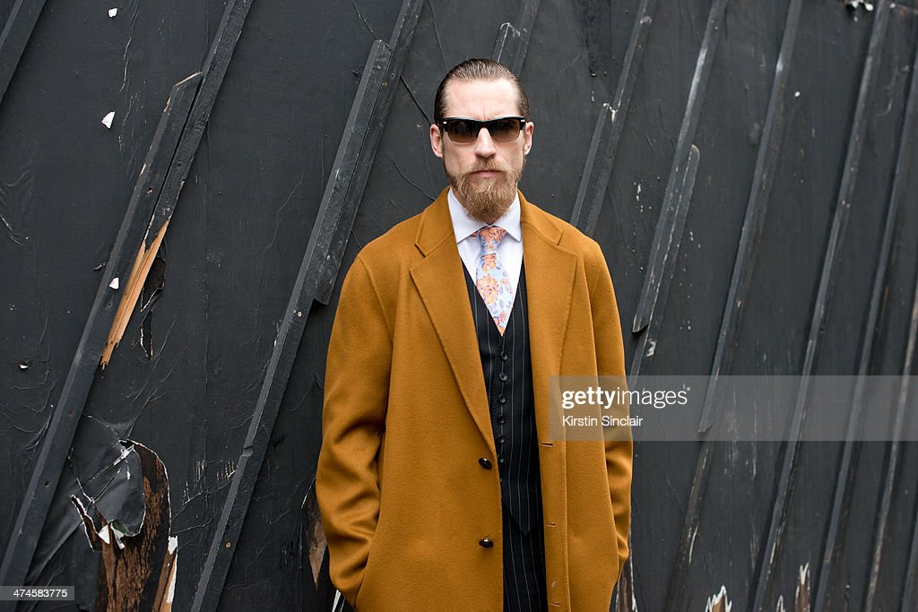 Buying Director for mytheresa.com Justin O'Shea wears an Acne coat, Doyle Mueser suit and M and S tie on day 4 of London Collections: Women on February 17, 2014 in London, England.