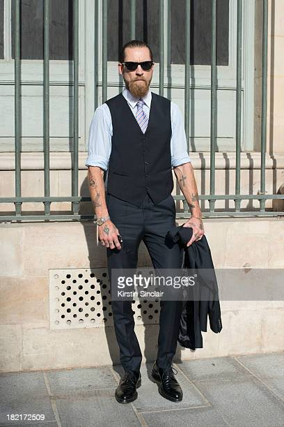 Buying director for Mytheresacom Justin O'Shea wears an Acne suit Prada shirt and shoes and Oliver Peoples sunglasses on day 4 of Paris Fashion Week...