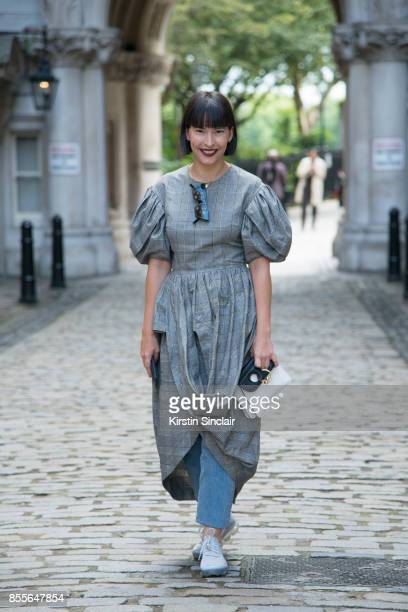 Buying director for The Webster Clara Cornet Nike trainers Simone Rocha dress and a JW Anderson bag with a puff sleeve grey dress on day 2 of London...
