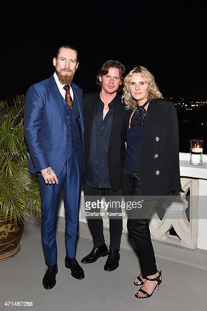 Buying director of mytheresacom Justin O'Shea creative director Christopher Kane and CEO of Christopher Kane Sarah Crook attend Christopher Kane x...