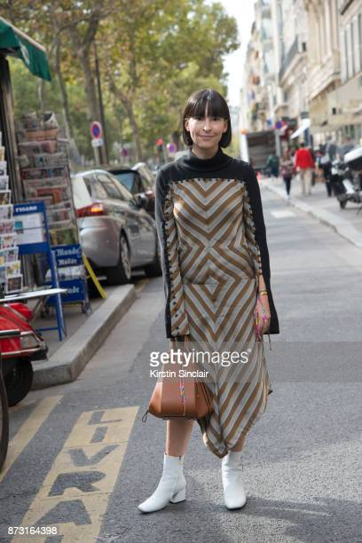 Buying director of The Webster Clara Cornet wears a Loewe dress and bag with JW Anderson boots day 4 of Paris Womens Fashion Week Spring/Summer 2018...