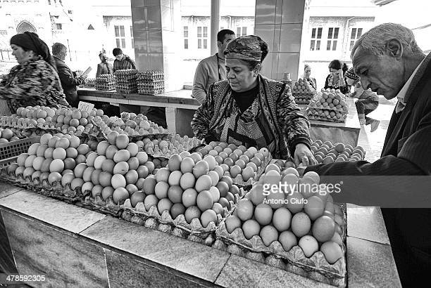 Buying eggs at market. According to the figures of 2012 of the World Bank, Uzbekistan is a country with an annual income of 3,523 dollars per capita...