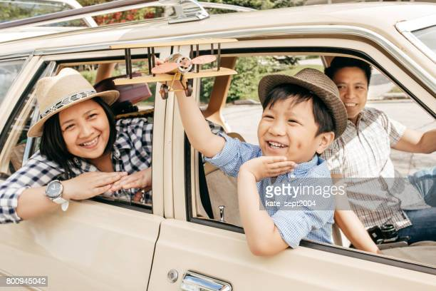 buying family car - family driving stock photos and pictures