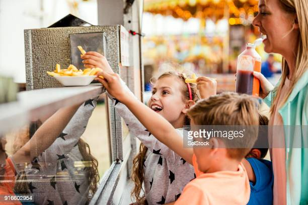 buying food at the fairground - fete stock photos and pictures
