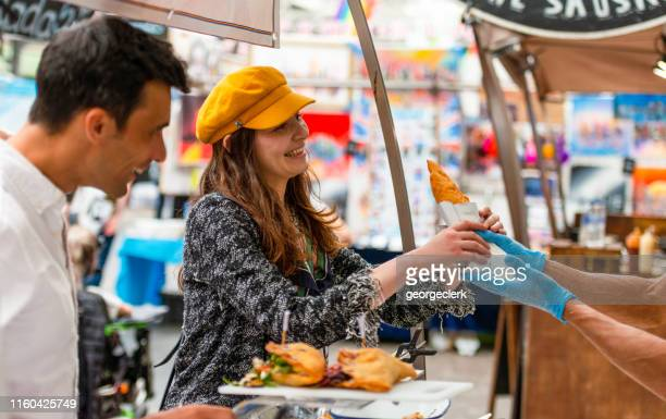 buying food in greenwich market - greenwich london stock pictures, royalty-free photos & images