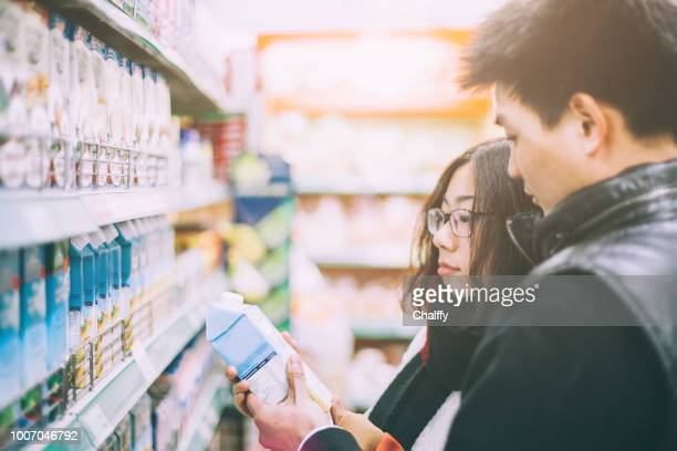 buying food in supermarket - convenience stock pictures, royalty-free photos & images