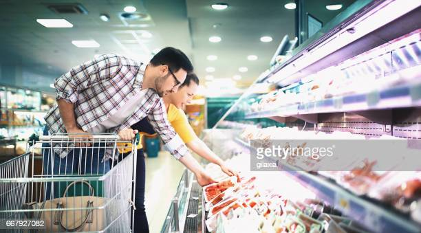 buying food in supermarket - meat stock pictures, royalty-free photos & images