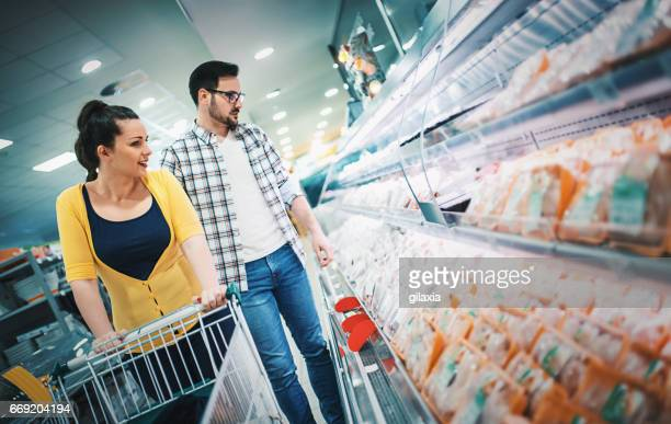Buying food in supermarket