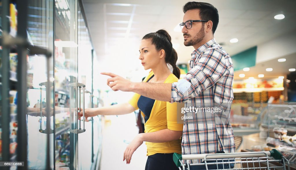 Buying food in supermarket : Stock Photo
