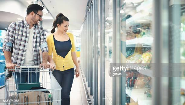 buying food in supermarket - freezer stock photos and pictures