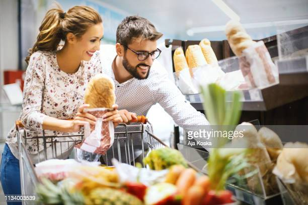 buying freshly baked bread. - gluten free bread stock pictures, royalty-free photos & images