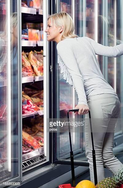 buying frozen food in supermarket