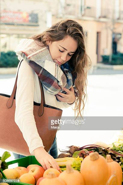 Buying groceries at an street market