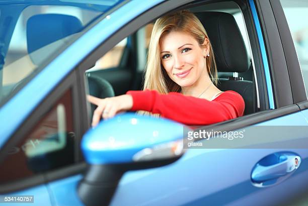 buying new car. - red shirt stock pictures, royalty-free photos & images