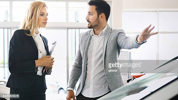 buying new car. - persuasion stock pictures, royalty-free photos & images
