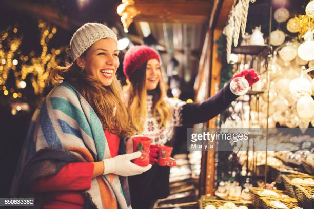 buying on christmas market - national holiday stock pictures, royalty-free photos & images