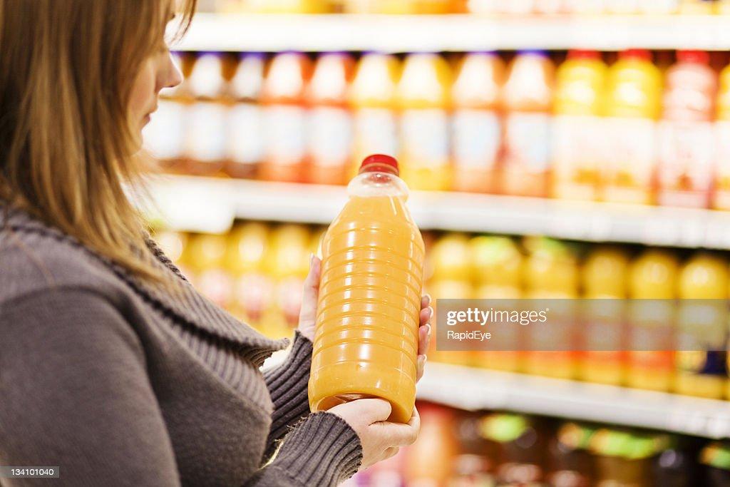 Buying orange juice : Stock Photo