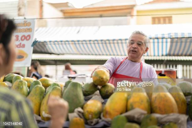 Buying Papaya on Farmers Market