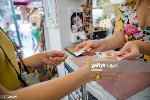 buying souvenirs in italy - euro symbol stock photos and pictures