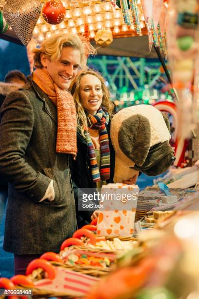buying sweets at winter market - pop up store stock pictures, royalty-free photos & images