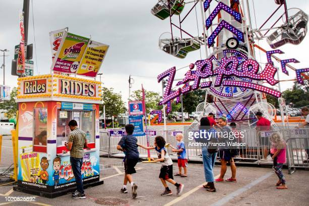 Buying tickets for rides near the Zipper during Opening Day of the CNE
