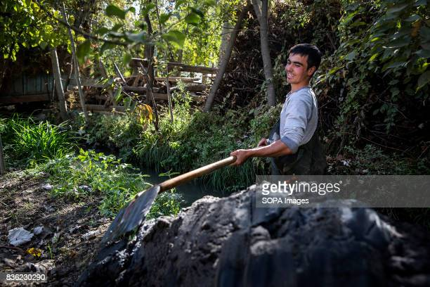 Buzruk Akmetov clears debris from an irrigation canal called an aryk in the village of Beshkent Kyrgyzstan The water they drink is vulnerable to...