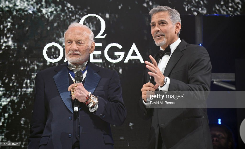 Buzz Aldrin and George Clooney attend the OMEGA 'Lost In Space' dinner to celebrate the 60th anniversary of the OMEGA Speedmaster, which has been worn by every piloted NASA mission since 1965, at Tate Modern on April 26, 2017 in London, England.