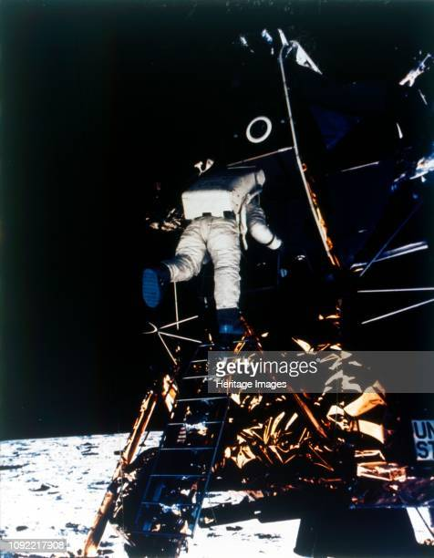 Buzz Aldrin descends from the Lunar Module Apollo II mission July 1969 Edwin Buzz Aldrin descends the steps of the Lunar Module ladder to walk on the...